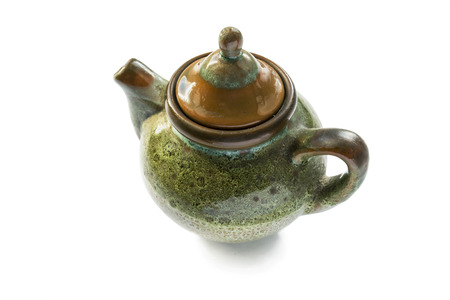 Little vintage ceramic teapot on white background photo