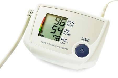 Electronic blood pressure monitor with indication on white background photo