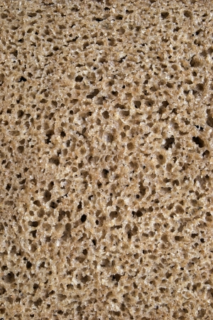 spongy: Texture of spongy brown rye bread closeup Stock Photo