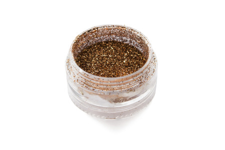 Opened jar with brown shine eye shadows isolated over white photo