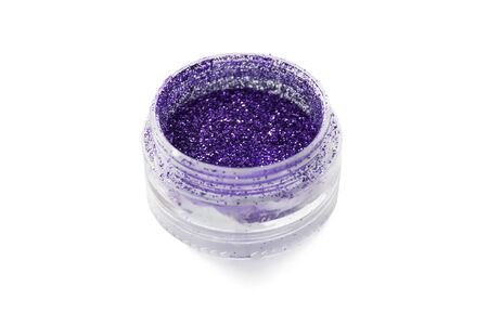 visagist: Violet metallic sparks in a jar isolated over white