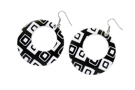 Big stylish black and white round earrings on white background photo