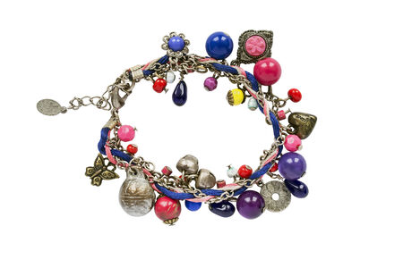 Bright bracelet with different beads on white background photo
