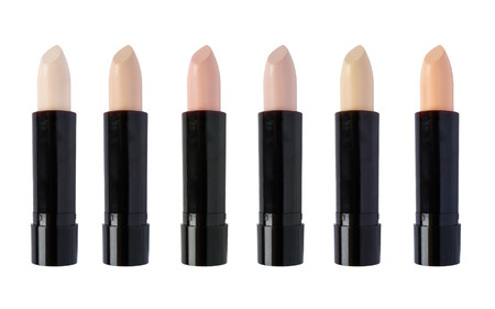 concealer: Six tones of concealer sticks isolated over white Stock Photo
