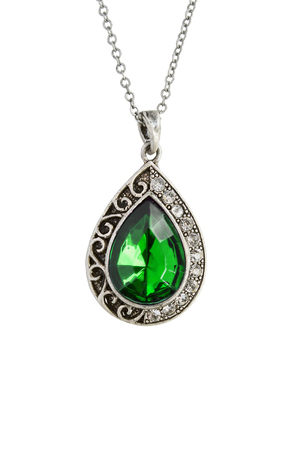 Silver vintage pendant with emerald isolated over white photo