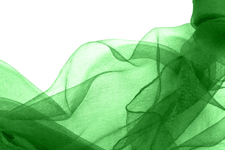 Abstract green transparent nylon over white as a background photo