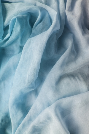 Light blue tender chiffon drapery as a background photo