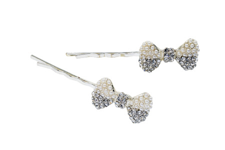Hairpins metal decorated with crystal bows isolated over white