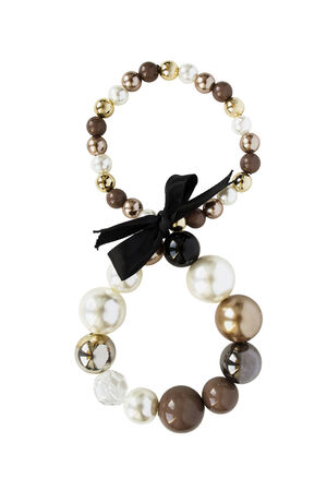 Elegant bracelet of brown golden and white beads decorated with black bow on white background photo