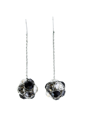Earrings on long chain with black and white crystal balls on white background photo