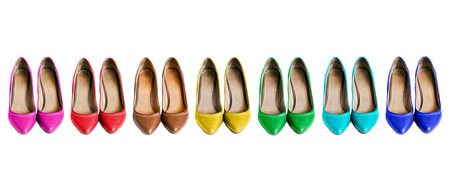 Pairs of leather multicolor high heels shoes on white background