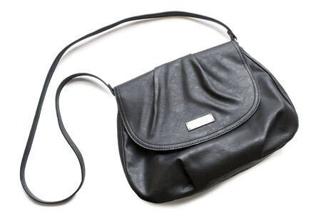 Classic little black leather bag on white background photo