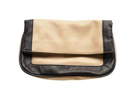 Beige leather handbag on white background photo