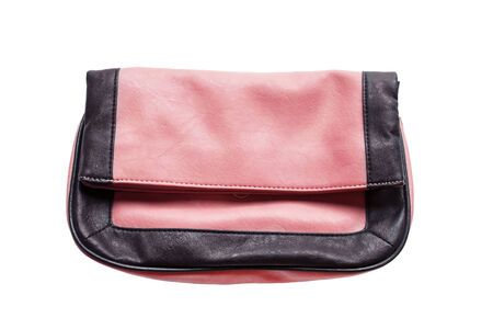 Pink leather clutch isolated over white photo