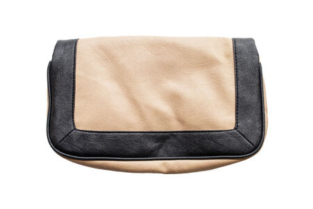 Beige and black classic handbag isolated over white photo