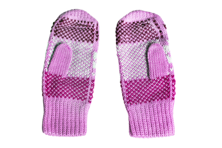 Pink wool knitted mittens on white background photo