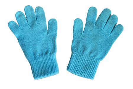 白で分離された明るい青いニット手袋 写真素材