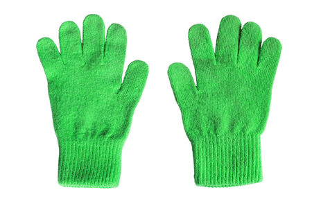 Pair of green wool gloves on white background Banque d'images