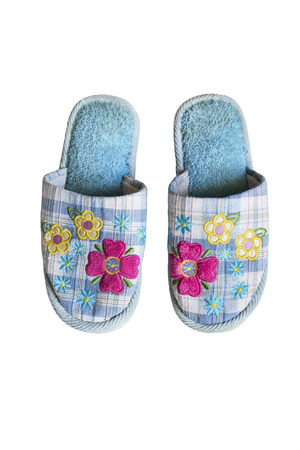 Pair of blue soft slippers isolated over white photo
