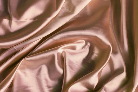 Beige silk draped as a background photo