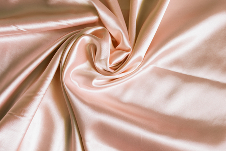 draped: Drapery of beige satin as a background Stock Photo