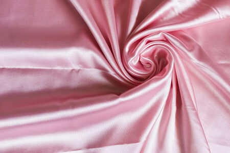 Draped pink satin as a background photo