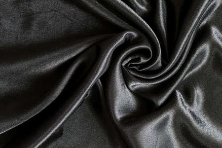 Draped black silk as a background photo