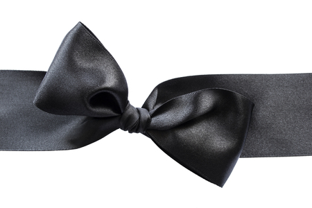black ribbon bow: Black satin bow isolated over white
