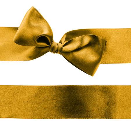 Golden decorative satin ribbon with a bow on white background photo