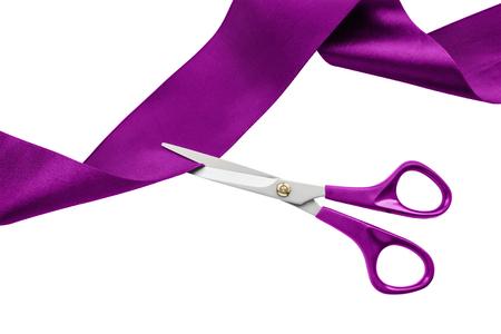 Scissors cut purple silk ribbon on white background