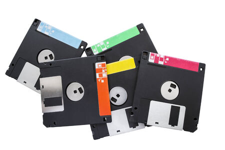 Group of floppy disks isolated over white photo