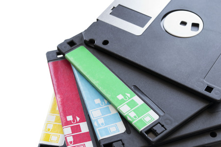 Stack of old floppy disks on white background