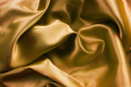 draped: Draped golden satin background