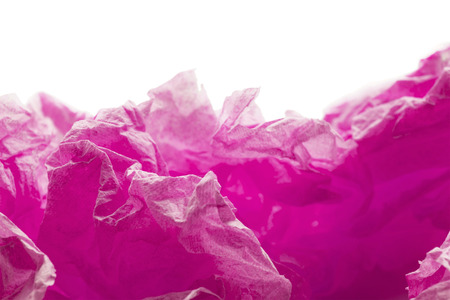 Pink crumpled paper on white abstract as a background photo
