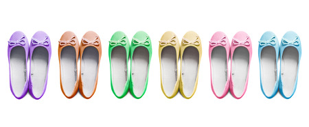 Set of multicolor textile flat shoes isolated over white photo