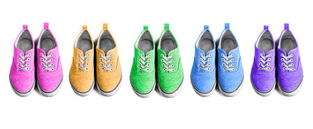 Set of multicolor sneakers on white background photo