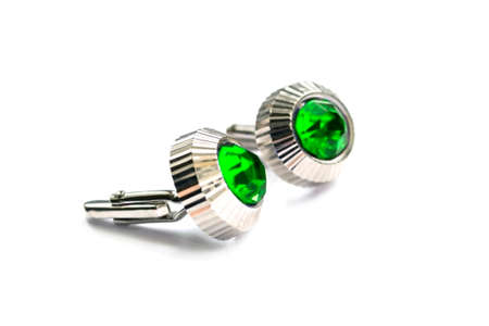 Cufflinks with green gems on white background photo