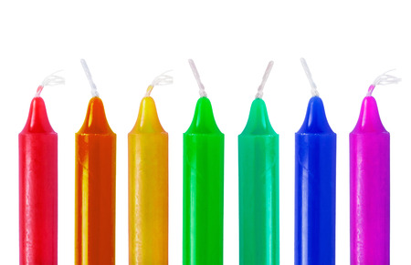 Set of multicolor long candles on white background photo