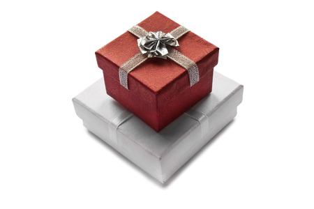 Red and white gift boxes isolated over white photo