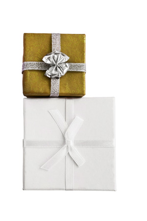 Golden and white gift boxes on white background photo
