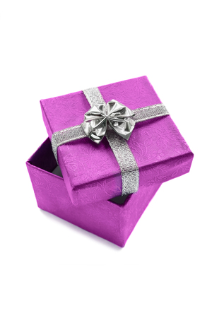 Pink silk gift box on white background closeup photo