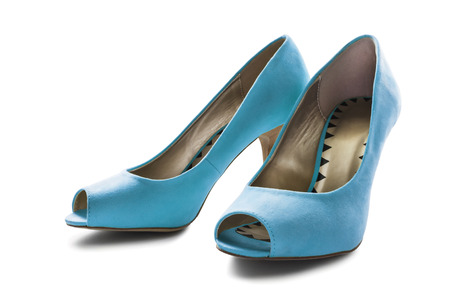 Pair of  elegant blue textile high heeled shoes on white background photo