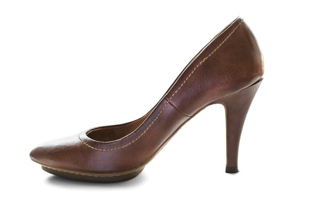 Classic leather brown high heeled shoe on white background photo