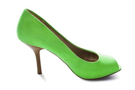 high heeled shoe: One green velvet high heeled shoe isolated over white Stock Photo