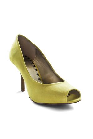 high heeled shoe: Elegant yellow textile high heeled shoe on white background
