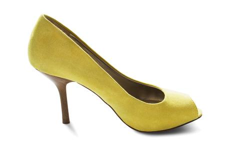 high heeled shoe: Yellow velvet high heeled shoe isolated over white