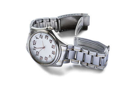 Classic male wristwatch on metal bracelet isolated over white photo