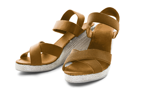 Pair of wedge heeled terracotta textile sandals  photo