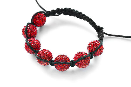 ethnical: Bracelet with seven red glass beads isolated over white