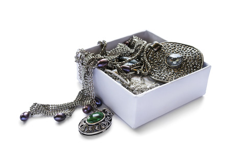 A lot of jewels in white opened box isolated over white photo